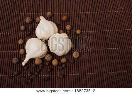 Head Of Garlic And Pepper
