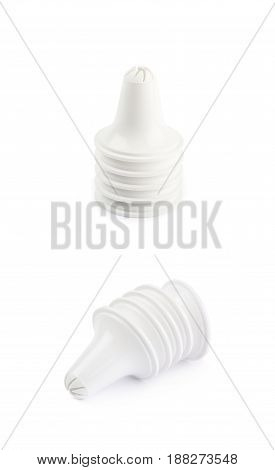 Decorational cream piping bag's plastic tip isolated over the white background, set of two different foreshortenings
