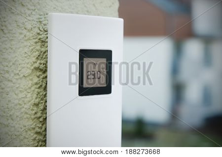 Wireless weather meter installed outdoor. weather station home equipment digital display climate concept