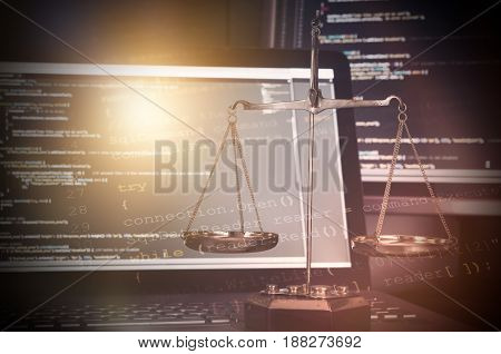 Justice Weight Scales With Code On Monitor In Background