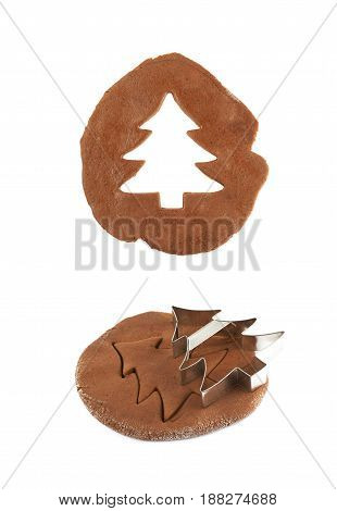 Rolled up thin layer of cookie dough and a christmas tree shaped cookie cut out of it, composition isolated over the white background, set of two different foreshortenings