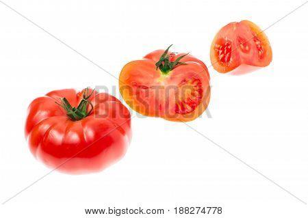 Red tomato isolated on white background. Studio Photo