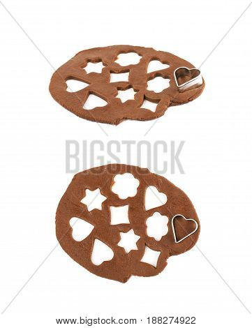 Rolled up thin layer of cookie dough with a heart shaped cookie cutter over it, composition isolated over the white background, set of two different foreshortenings