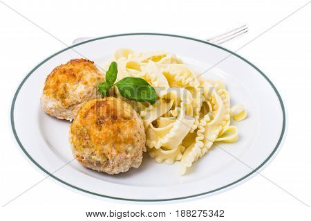 Pasta with cutlets for lunch. Studio Photo