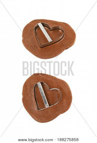 Rolled up thin layer of cookie dough and a heart shaped cookie cut out of it, composition isolated over the white background, set of two different foreshortenings