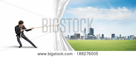 Businessman pulling white blank fabric. Place for text