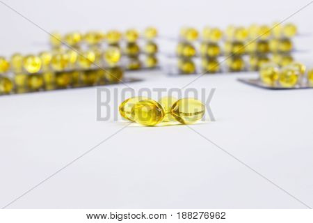 Fish Oil Capsules On White Background.