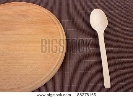 Empty Wooden Cutting Board. Wooden Spoons And Wooden Plates.