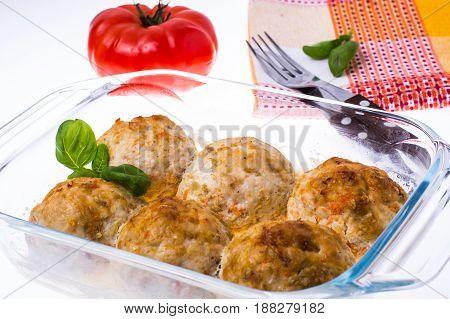 Grilled meatballs in  glass  frying pan. Studio Photo