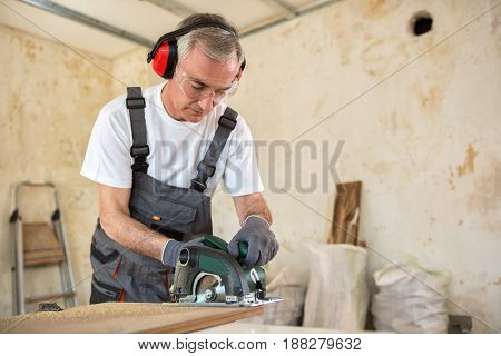 Carpenter Is Working In A Workshop