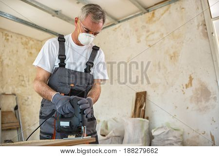 Carpenter Working With Wood Plank At Workshop
