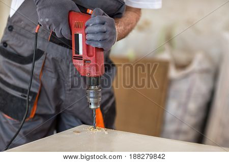 Carpenter Used Drills  In Reparation Of Old Doors
