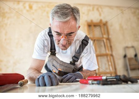 Carpenter Is Working In A Workshop