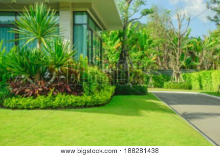 Blurred background, Modern house with beautiful landscaped front yard,Lawn and garden