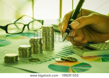 Financial analysis concept with coins, graph, calculator and eyewear