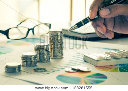 Financial analysis concept with coins, graph and eyewear