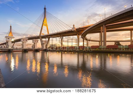 Twin suspension brige and highway intersection over white watergate Bangkok Thailand