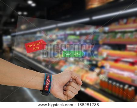 iotinternet of things marketing concept man use smart watch with augmented reality technology to search discountpromotion at the retail