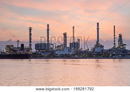 Beautiful after sunset sky tone over oil refinery river front