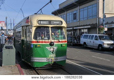 San Francisco California - February 14 2010: Vintage tram cable trolley car on the streets of San Francisco going to Fisherman's Wharf.