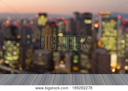 Opeing wooden floor Business building blurred light night view Osaka city downtown abstact background