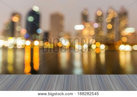 Opening wooden floor Night blurred light office city building with reflection abstact bakground