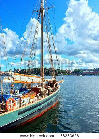 Colorful sailboat. Sunny summer day in Stockholm Sweden.