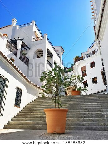 White houses of Frigiliana. Street decorated with plants. Andalusia Spain.