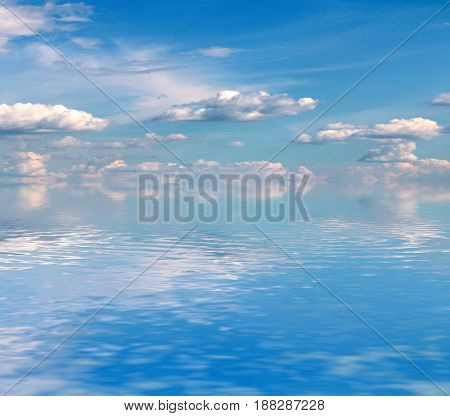 Beautiful surface of a calm sea and a cloudy sunny sky on the horizon