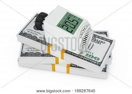 Energy Saving Concept. Digital Wireless Radiator Thermostatic Valve over Stack of Money on a white background. 3d Rendering.