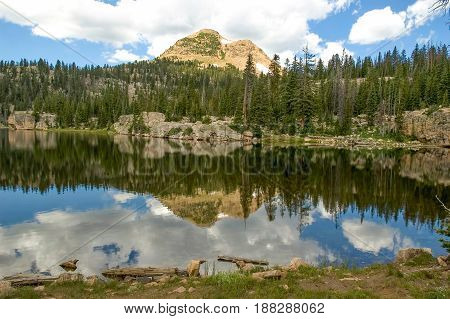 Reflection of the mountains in Island Lake located in the High Uintas