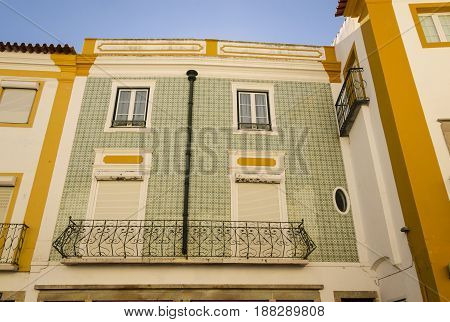 typical portugues palace with a facade full of tiles evora portugal