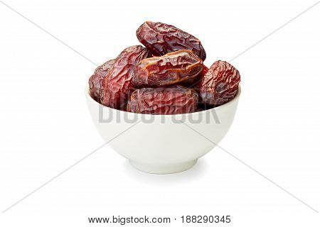 Bowl of dried date fruits isolated on white background