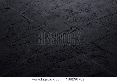 Dark grey grunge rough concrete texture wall.