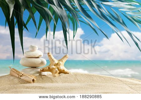 Starfish and sea stones are placed on the background of beautiful sea landscape . Suitable as a card.