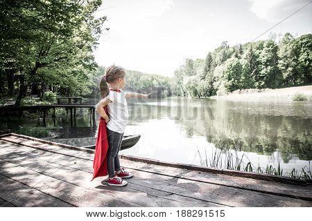 Little Cute Girl In Costume Of A Super Hero