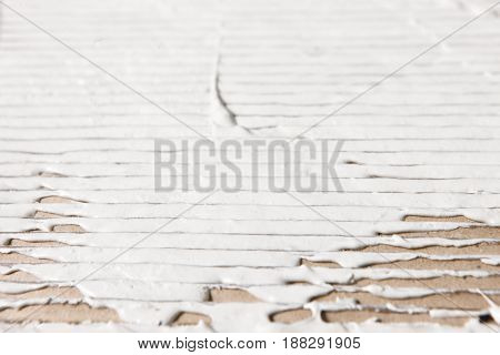 White Wet Plaster Spread Corrugated Cardboard Texture Surface Repair Closeup Stucco Free Space Concept