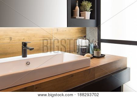 Bathroom interior with sink and faucet. .