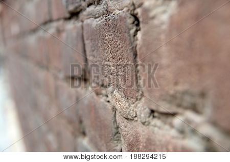 Brick wall macro view close-up bricks background with blur and bokeh
