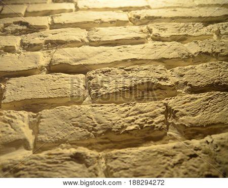Brick wall texture photo close-up macro view with bokeh