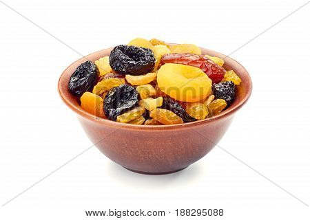 Bowl of dried fruits mix isolated on white background