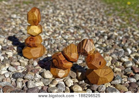 balancehand made wood blocks on the stones
