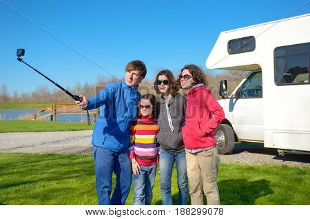 Family vacation, RV travel with kids, happy parents with children have fun and make selfie on holiday trip in motorhome, camper exterior poster
