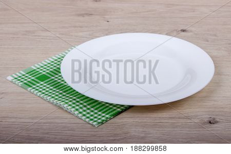 Top View Of Clean Empty Plate On Wooden Tabletop