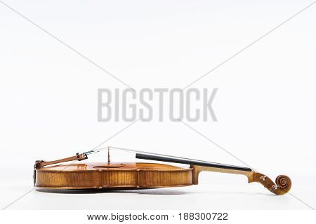 The old fiddle isolated on white background. Viola Instrument for classical music.