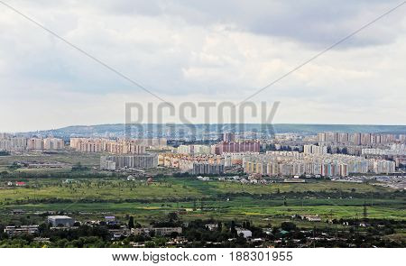 View to the outskirts of the city from a bird's eye view.