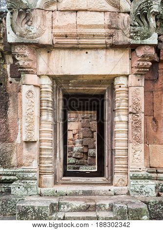 Sandstone door with the dragon sculpture in the traditional Cambodian style of the ancient castle in the historical parkThailand (Public area not required Property Release)