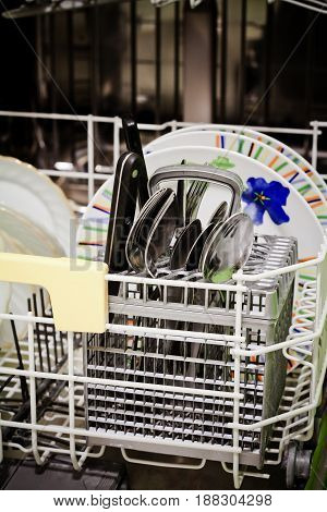 Plates and place settings in dishwasher machine