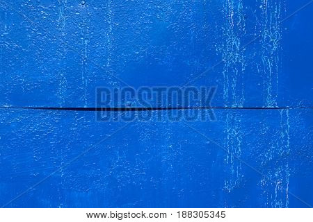 Cracked painted old metal texture. Deep blue old shaggy metal texture background
