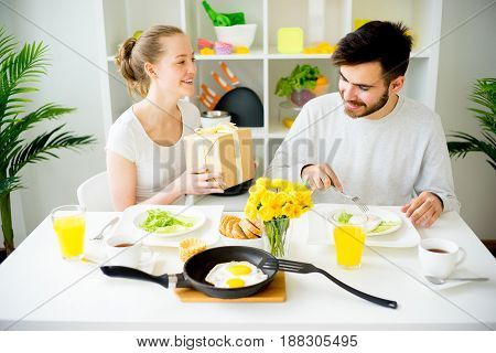 Couple eating breakfast in the morning birthday